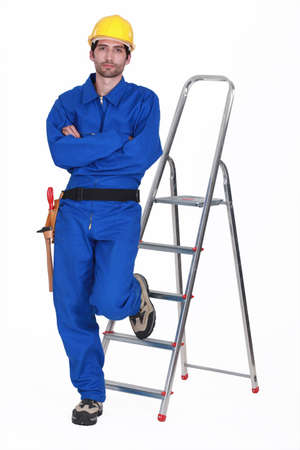 laborers: Laborer leaning on a ladder, studio shot
