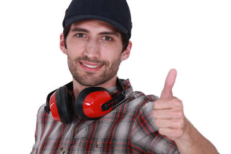 defenders: Thumbs up from a man with ear defenders
