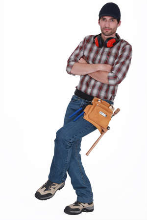 noise isolation: Builder stood with arms crossed Stock Photo