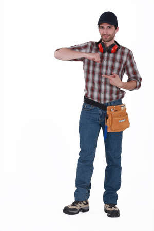 anti noise: full-body portrait of handsome carpenter wearing cap Stock Photo