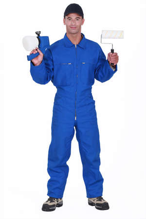 boiler suit: A painter holding a paint airbrush
