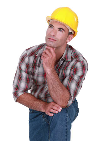 fantasize: Tradesman with a dreamy look on his face