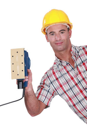 Worker with a sander Stock Photo - 15856137
