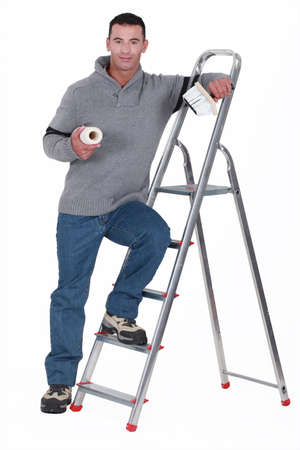 refinish: Painter resting on a stepladder