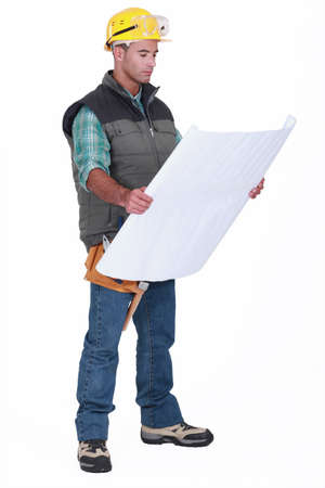 superintendent: A foreman checking blueprints