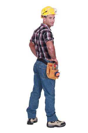 hands behind back: Portrait of a tradesman looking over his shoulder Stock Photo