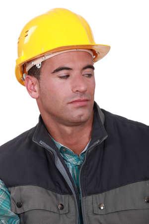 aslant: Construction worker looking sideways