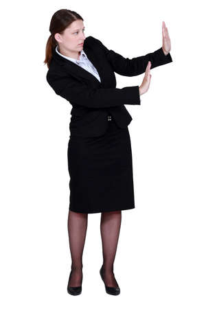 banish: woman in a suit trying to protect herself with her hands