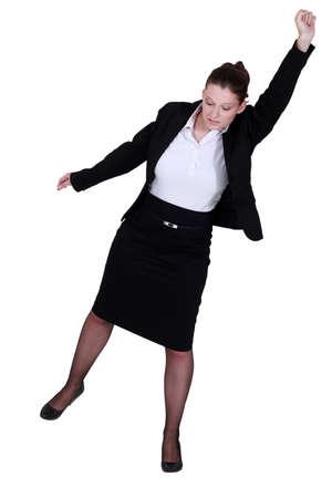 chignon: A businesswoman raising her fist to the sky