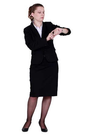 watch over: Businesswoman looking at wrist watch