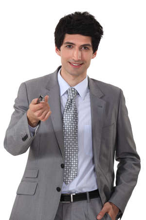 Young businessman offering his pen Stock Photo - 15861809