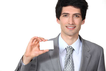 Executive with a blank business card photo