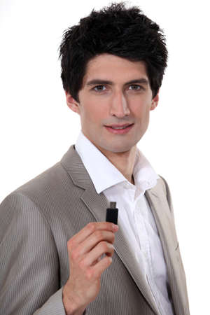 Businessman holding USB stick photo