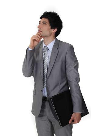 Pensive businessman rubbing his chin Stock Photo - 15857392