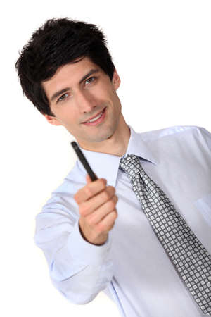 Businessman holding out a pen Stock Photo - 15862076