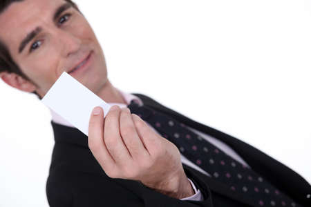 affiliation: Man holding up a blank card Stock Photo