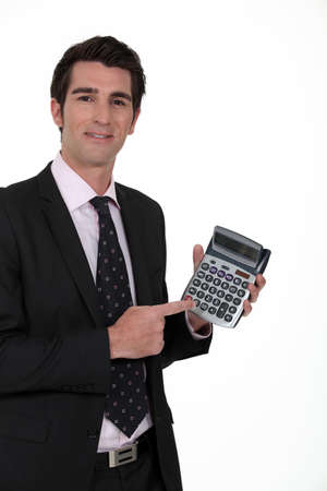 Businessman with a calculator photo