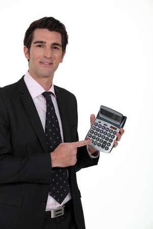 numerate: Businessman with a calculator