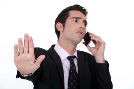 annoy: businessman receiving important call