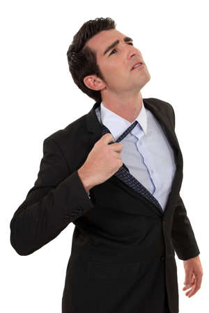 uncomfortable: Man loosing tie
