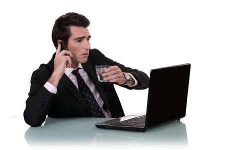 multitask: Businessman multitasking