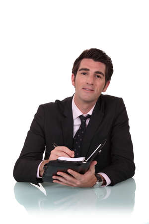 Man writing in his agenda Stock Photo - 15854477