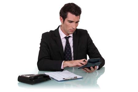 worker using calculator photo