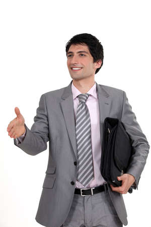 non verbal: Businessman holding his hand out for a handshake Stock Photo