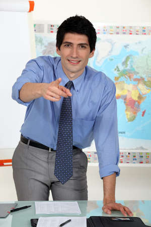 young business teacher pointing at you photo