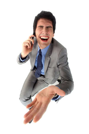 ridiculous: Businessman laughing hysterically Stock Photo