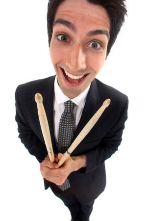 odd jobs: Businessman holding drum sticks