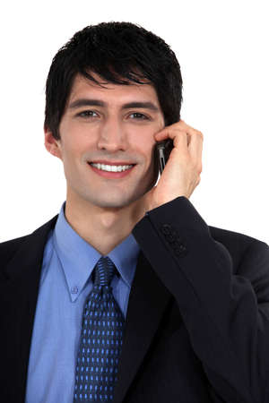 30 40: Businessman talking on his mobile phone Stock Photo