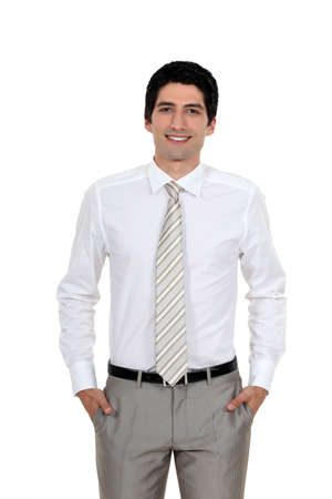 all smiles: young handsome businessman all smiles