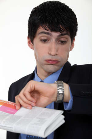 Businessman staring at his watch in disbelief Stock Photo - 15856882