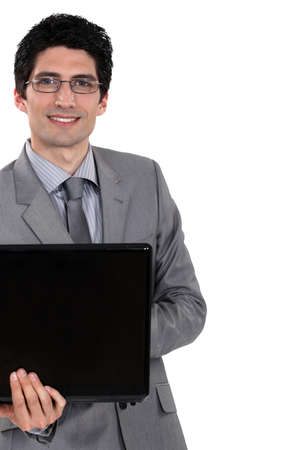 Cheerful businessman holding laptop computer photo