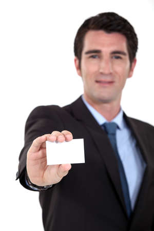 Executive proffering his businesscard photo