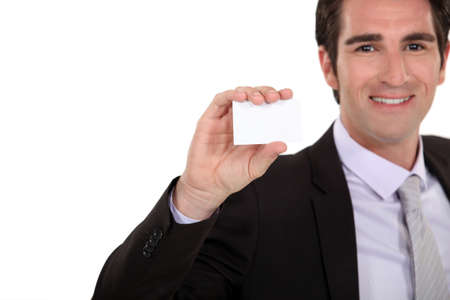 Confident businessman presenting card Stock Photo - 15852947