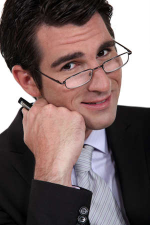 40 45: Businessman peering over his glasses