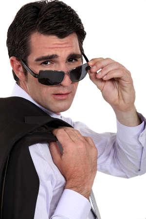 bad leadership: Cool businessman wearing sunglasses Stock Photo