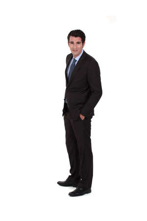 poise: Man with hands in pockets Stock Photo