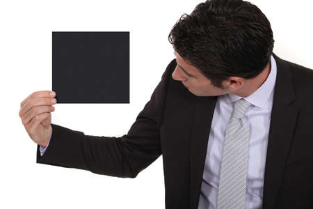 Businessman looking at a blank square photo