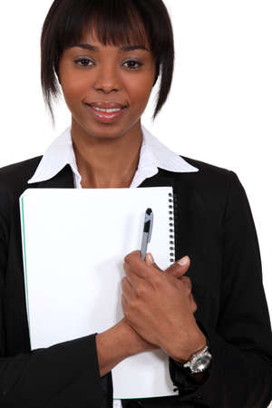 critique: Businesswoman holding notepad and pen Stock Photo