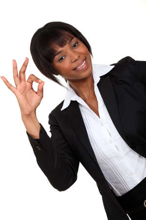 Businesswoman making an OK sign Stock Photo - 15856009