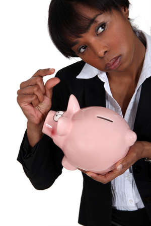 A businesswoman holding a piggy bank  photo