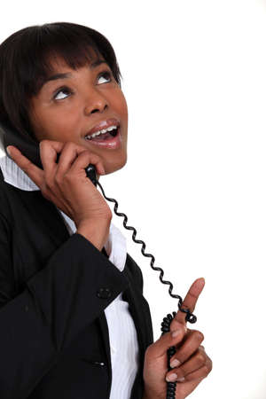 flip phone: Businesswoman receiving good news over the phone Stock Photo