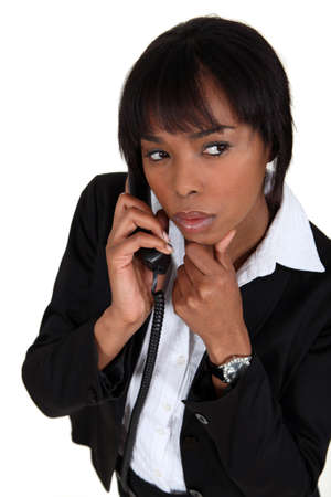 suspicious: Suspicious woman talking on the phone