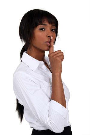 shushing: Businesswoman shushing Stock Photo