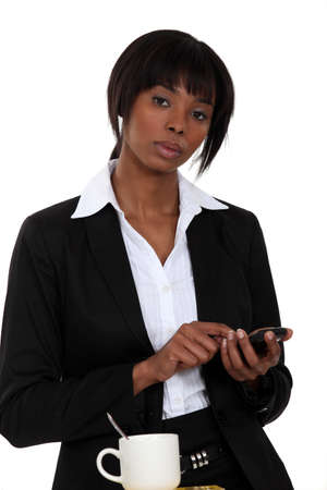 Businesswoman tapping a cellphone photo