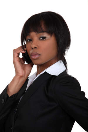 Serious businesswoman with a phone Stock Photo - 15854727