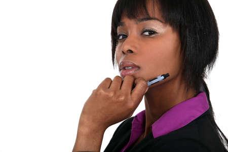 hand holding pen: Smart businesswoman thinking